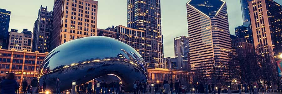 The Cloud Gate sculpture in Chicago with the city skyline behind