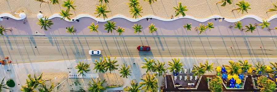 Birds eye view of road running alongside a Miami beach
