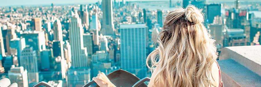 Girl looking at New York Skyline from the Rock